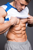 Bodybuilder. The beautiful and strong young guy Royalty Free Stock Photos