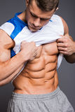 Bodybuilder. The beautiful and strong young guy Stock Image
