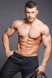 Bodybuilder. The beautiful and strong young guy Royalty Free Stock Photo