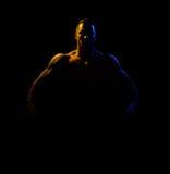 Bodybuilder on black background Stock Photos