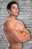 Bodybuilder bodybuilding muscles strong wall muscular young man Royalty Free Stock Photography