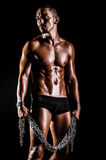 Bodybuilder with chains Royalty Free Stock Image