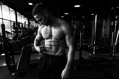 Bodybuilder checking His Percent of Fat Royalty Free Stock Image