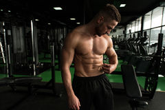 Bodybuilder checking His Percent of Fat Royalty Free Stock Photo