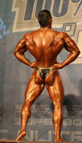Bodybuilder in a competition. Young posing bodybuilder in superbody , Budapest, Hungary 2007 October Molnár Péter Royalty Free Stock Image