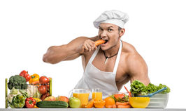 Bodybuilder cook Stock Images