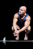 Bodybuilder crouching by crossfit Stock Image