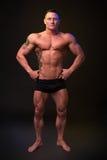 Bodybuilder on a dark background Royalty Free Stock Image