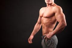 Bodybuilder on a dark background Stock Photos