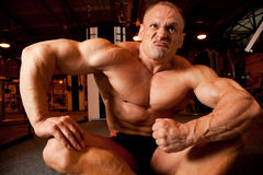 Bodybuilder demonstrates his muscles Stock Photo
