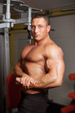 Bodybuilder demonstrating pose in fitness club Royalty Free Stock Images