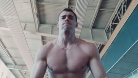 Bodybuilder does exercise with barbell stock footage