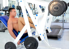 Bodybuilder does leg presses. Royalty Free Stock Photo