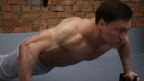 Bodybuilder does push-ups in the fitness club. Handsome guy with muscular body stock video