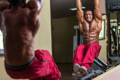 Bodybuilder doing abs exercise Stock Image