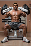 Bodybuilder Doing Exercise For Shoulders Stock Photos