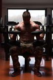 Bodybuilder Doing Exercise For Shoulders Royalty Free Stock Image
