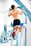 Bodybuilder doing exercises Stock Photos