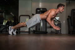 Bodybuilder Doing Extreme Push Ups On Floor Royalty Free Stock Image