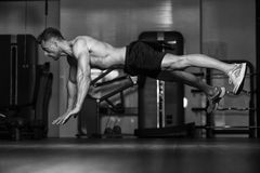 Bodybuilder Doing Extreme Push Ups On Floor Royalty Free Stock Photography