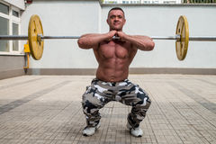 Bodybuilder Doing Front Squats With Barbells Stock Photography