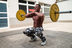 Bodybuilder Doing Front Squats With Barbells Stock Photo