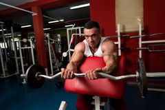 Bodybuilder Doing Heavy Barbell Exercise Royalty Free Stock Images