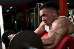 Bodybuilder Doing Heavy Barbell Exercise Stock Photo