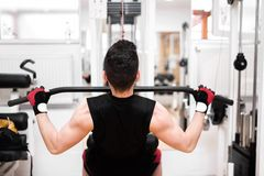 Bodybuilder Doing Heavy Weight Exercise For Back Royalty Free Stock Image