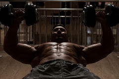 Bodybuilder Doing Heavy Weight Exercise For Chest Stock Photos