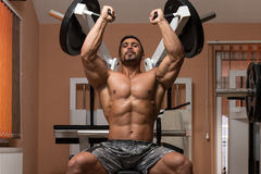 Bodybuilder Doing Heavy Weight Exercise For Shoulders Royalty Free Stock Photos