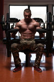 Bodybuilder Doing Heavy Weight Exercise For Shoulders Stock Images
