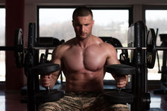 Bodybuilder Doing Heavy Weight Exercise For Shoulders Royalty Free Stock Photography