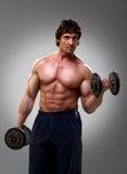 Bodybuilder doing his biceps stock photography