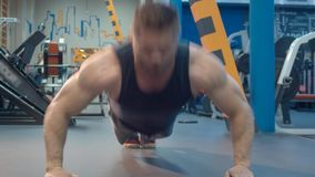 Bodybuilder doing push up stock footage