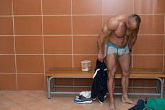 Bodybuilder In Dressing Room - Undressing His Clothing Stock Image