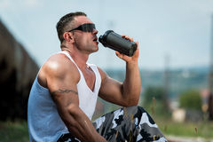 Bodybuilder Drinking Stock Images