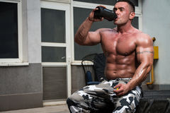 Bodybuilder Drinking Stock Image