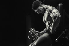 Bodybuilder drinking water after fitness workout. Bodybuilder strong athletic rough man drinking water after workout workout fitness and bodybuilding healthy