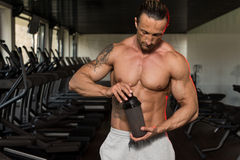 Bodybuilder Drinking Water From Shaker Royalty Free Stock Images
