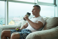 Bodybuilder Drinking Water From Shaker Royalty Free Stock Photography