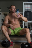 Bodybuilder Drinking Whey Protein Royalty Free Stock Image