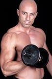 Bodybuilder dumbbell. On black background Stock Photos