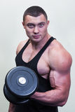 Bodybuilder with a dumbbell Royalty Free Stock Images