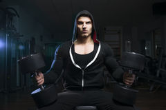 Bodybuilder with dumbbell Stock Photography