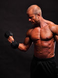 Bodybuilder with dumbbell Stock Photos