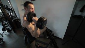 Bodybuilder with dumbbells. stock video