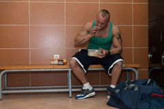 Bodybuilder Eating Healthy Diet Food Out Of Tupperware Royalty Free Stock Photography