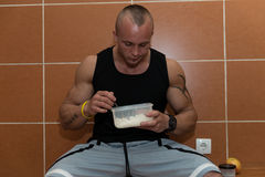 Bodybuilder Eating Healthy Diet Food Out Of Tupperware Stock Photo