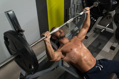 Bodybuilder Exercise Bench Press With Barbell Royalty Free Stock Photos